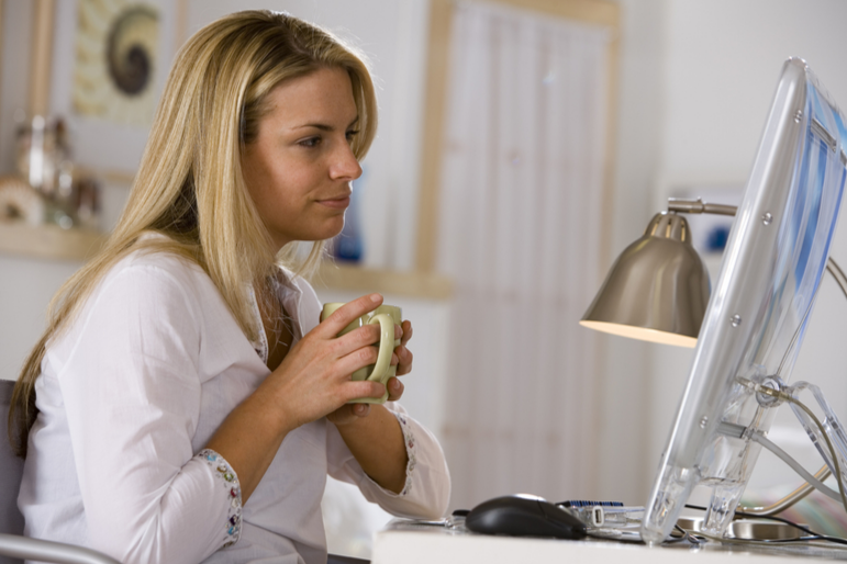 Women in front of computer with coffee